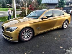 Gold BMW full vehicle wrap